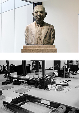 増永五左衛門の銅像と当時の帳場の再現(めがねミュージアム)